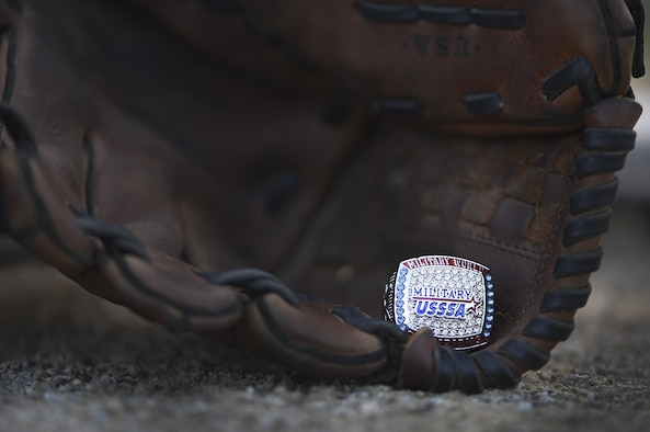 A U.S. Special Sports Association Military World Series ring rests in a glove on Joint Base Andrews, Md., Aug. 23, 2017. Approximately 20 women from the National Capital Region who make up the Lady Not Forgotten softball team brought back the winning title from the tournament held every year in August in Augusta, Ga., Aug. 14.