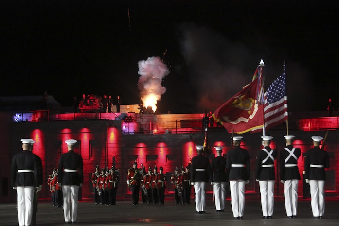 Marines with Marine Barracks Washington D.C. render honors as members of the Fort Henry Guard fire cannons at the closing of a combined ceremony at Kingston, Ontario, Canada, Aug. 19, 2017. This visit marked the anniversary of the Ogdensburg Agreement, which was signed by President Roosevelt and Prime Minister King to bind the two nations in the combined defense of North America. Since then, the two units have paraded together countless times both at the Fort and at Marine Barracks Washington. Sgt. Brandon T. Webb, mascot handler, escorts Corporal Chesty XIV, official Marine Corps mascot, during a combined ceremony at Kingston, Ontario, Canada, Aug. 19, 2017. This visit marked the anniversary of the Ogdensburg Agreement, which was signed by President Roosevelt and Prime Minister King to bind the two nations in the combined defense of North America. Since then, the two units have paraded together countless times both at the Fort and at Marine Barracks Washington. (Official U.S. Marine Corps photo by Lance Cpl. Damon McLean/Released)