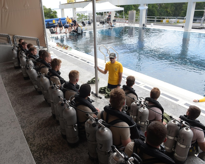 An instructor gives a briefing to diving students before a training exercise at Naval Support Activity Panama City, Fla., Aug. 2, 2017. The diving instructors teach qualified candidates how to become proficient military divers in support of naval, joint and allied operations.