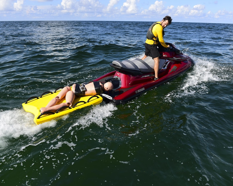 A Naval Diving and Salvage Training Center instructor transports a mannequin for a recovery exercise in the Gulf of Mexico, Aug. 15, 2017. The exercise involved dropping mannequins and ruck sacks to the bottom of the Gulf and the students pulling them out to simulate an underwater recovery mission.