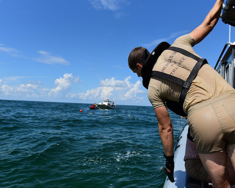 A U.S. Air Force diving student observes the rest of his team during a training exercise in the Gulf of Mexico, Aug. 15, 2017. The vision of the dive school is to develop the 'whole' diver, mind, body and heart, with the skills and confidence to successfully complete missions and integrate with all combat forces to offset our adversaries in the undersea domain.
