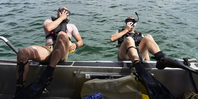U.S. Air Force diving students fall back into the ocean during a recovery exercise in the Gulf of Mexico, Aug. 15, 2017. The Naval Diving and Salvage Training Center schoolhouse provides both a controlled diving environment, as well as direct access to open water diving throughout the Gulf of Mexico.