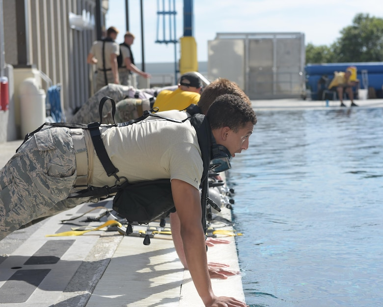 U.S. Air Force diving students prepare for the morning's dive training by doing a set of pushups at Naval Support Activity Panama City, Fla., Aug. 2, 2017. Both pararescue and combat controller Airmen get their dive training at the Naval Diving and Salvage Training Center.