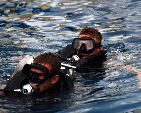 U.S. Air Force diving students tread water in their dive gear at Naval Support Activity Panama City, Fla., Aug. 3, 2017. The dive school's vision is to develop the 'whole' diver, mind, body and heart, with the skills and confidence to successfully complete missions and integrate with all combat forces to offset our adversaries in the undersea domain.