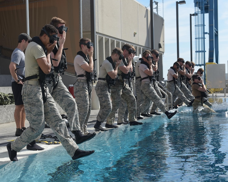 U.S. Air Force diving students take the plunge for their first dive of the day at Naval Support Activity Panama City, Fla., Aug. 2, 2017. The Naval Diving and Salvage Training Center is the home of research, development, testing and evaluation on diving matters. Certification and training is conducted constantly to support the nation's military diving requirements.