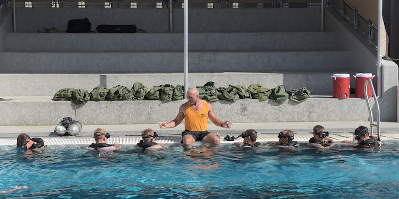 Sean McGinley, Naval Diving and Salvage Training Center instructor, gives tips to students going through the course at Naval Support Activity Panama City, Fla., Aug. 2, 2017. The diving instructors teach qualified candidates how to become proficient military divers in support of naval, joint and allied operations.