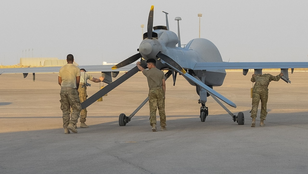 Soldiers from Company D, 10th Aviation Regiment, 10th Mountain Division, move a MQ-1C Gray Eagle unmanned aerial vehicle into position.