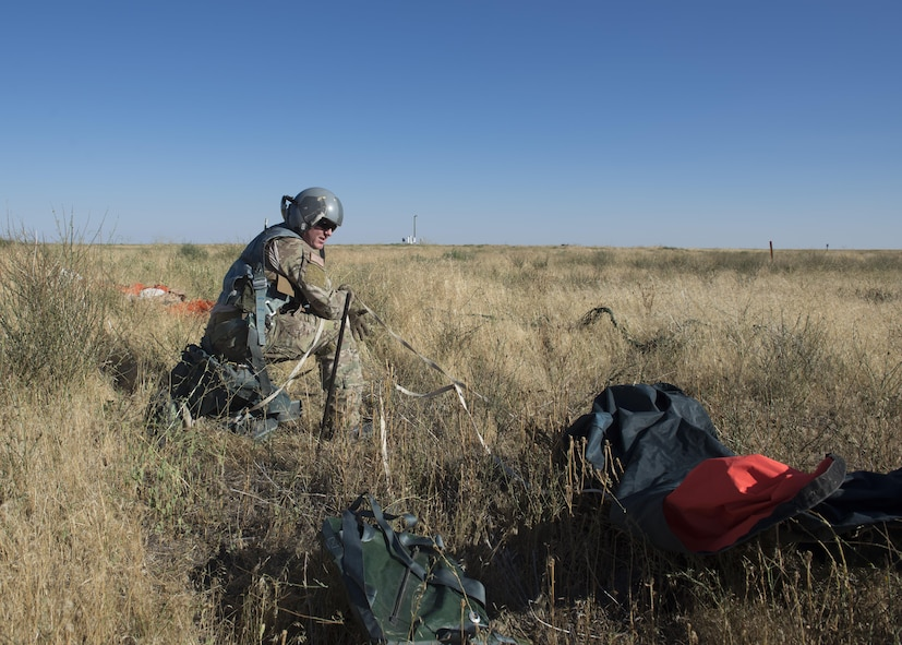 Tech Sgt. Isaac Denton, 366th Operations Support Squadron survival, evasion, resistance and escape specialist recovers his gear in a simulated landing during Combat Survival Training August 17, 2017, at Mountain Home Air Force Base, Idaho. SERE specialist's primary mission is to support air crew by teaching them the best methods of survival in the event they need to eject. (U.S. Air Force photo by Airman 1st Class Jeremy D. Wolff/Released)