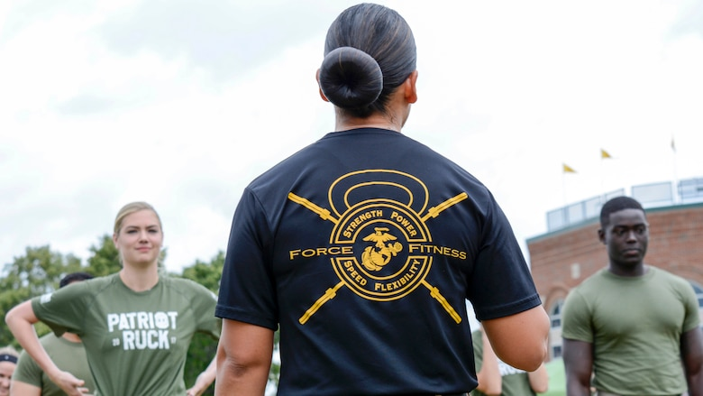Kate Upton and others listen to instructions from GySgt. Sara Pacheco before executing a workout Wayne State University's athletic complex in Detroit on August 22. Upton and others completed a circuit course consisting of several rounds of burpees, sprints, jumping jacks and more in an effort to promote Marine Week Detroit that takes place Sept. 6-10. Marine Week Detroit is a four-day event that will showcase hands-on static displays, live demonstrations, time-honored Marine Corps traditions, musical performances and other events highlighting the history, military capabilities and community involvement of the Corps (U.S. Marine Corps Photo by GySgt. Joseph DiGirolamo)