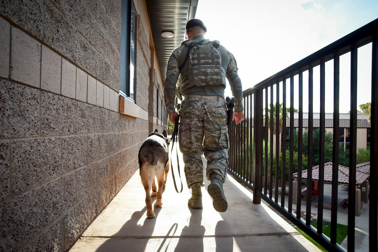 Senior Airman Ryne Wilson, 99th Security Forces Squadron military working dog handler, and MWD Habo patrol the dorms at Nellis Air Force Base, Nevada, August 7, 2017. Wilson and Habo perform dorm patrols to ensure the safety and security of the Airmen living there. (U.S. Air Force photo by Airman 1st Class Andrew D. Sarver/Released)
