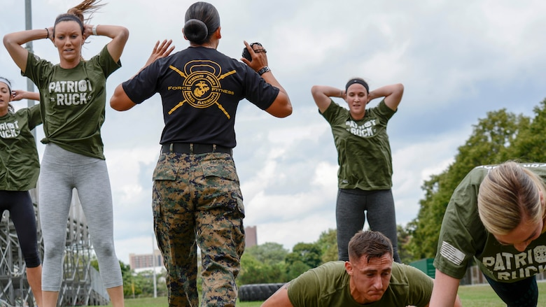 Gunnery Sgt. Sara Pacheco, force fitness instructor, shouts instructions during a workout at Wayne State University's athletic complex in Detroit on Aug. 22, 2017. Pacheco led Kate Upton, the Detroit Tigers Wives, and Marines through a circuit course consisting of several rounds of burpees, sprints, jumping jacks and more in an effort to promote Marine Week Detroit that takes place Sept. 6-10. Marine Week Detroit is a four-day event that will showcase hands-on static displays, live demonstrations, time-honored Marine Corps traditions, musical performances and other events highlighting the history, military capabilities and community involvement of the Corps