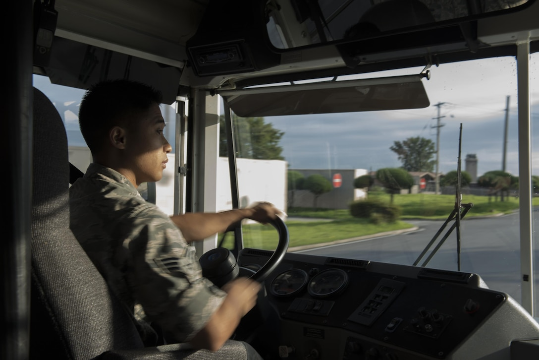 Senior Airman Darren Kimura, an 18th Logistics Readiness Squadron vehicle operator deployed from Kadena Air Base, Japan, drives a 44 passenger bus in support of the annual Ulchi Freedom Guardian exercise August 17, 2017, at Osan Air Base, Republic of Korea. UFG is designed to enhance readiness, protect and maintain stability in the region. Exercise participants conduct rigorous computerized simulations designed to test their ability to defend the Korean peninsula. (U.S. Air Force photo by Senior Airman Jacob Skovo)