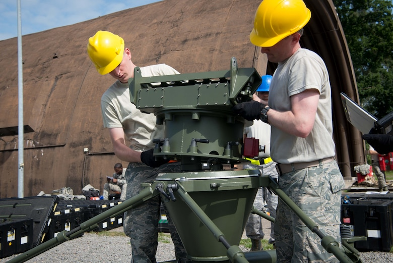 U.S. Airmen assigned to the 1st Combat Communications Squadron assemble a small aperture antenna during Exercise Lending Hand on Ramstein Air Base, Germany, Aug. 21, 2017.