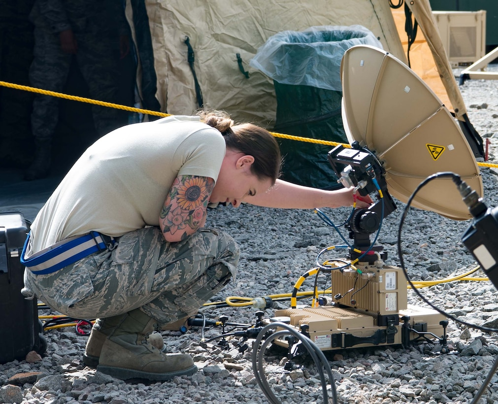 U.S. Air Force Senior Airman Elizabeth Arthur, 1st Combat Communications Squadron radio frequency transmission systems technician, adjusts a communications satellite during Exercise Lending Hand on Ramstein Air Base, Germany, Aug. 21, 2017.