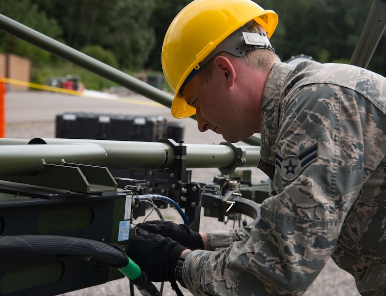 U.S. Air Force Airman 1st Class John Fitzpatrick, 1st Combat Communications Squadron radio frequency technician, assembles a small aperture antenna on Ramstein Air Base, Germany, Aug. 21, 2017.