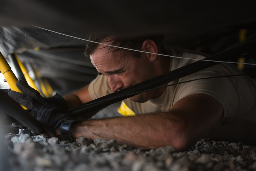 A U.S. Airman assigned to the 1st Combat Communications Squadron replaces a tent pole during Exercise Lending Hand on Ramstein Air Base, Germany, Aug. 21, 2017.