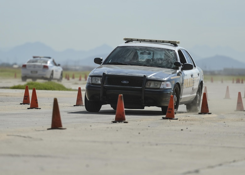 A city of El Mirage police cruiser is driven through a staged as part of an Emergency Vehicle Operations Course held at Luke Air Force Base, Ariz., Aug. 23, 2017. The EVOC training is scheduled to take place in the future as part of an ongoing partnership between local police departments and Luke Air Force Base. (U.S. Air Force photo/Airman 1st Class Caleb Worpel)