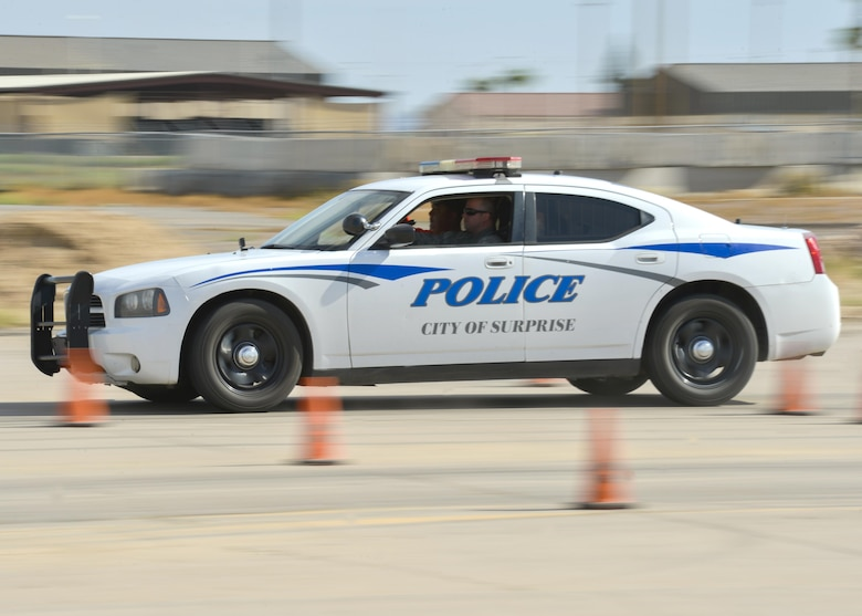 A city of Surprise police cruiser is driven through a staged course as part of an Emergency Vehicle Operations Course held at Luke Air Force Base, Ariz., Aug. 23, 2017. The EVOC training provided hands-on, realistic training to the 56th Security Forces Squadron as well as local police departments. (U.S. Air Force photo/Airman 1st Class Caleb Worpel)