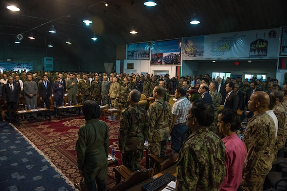 Afghan and Coalition service members listen to Afghan Brig. Gen. Mohammad Shoaib, Afghan Air Force commander, during an Afghan Air Force anniversary ceremony Aug. 24, 2017, in Kabul, Afghanistan.