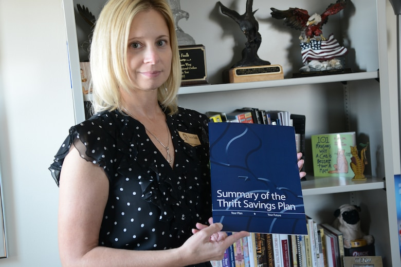 Tracie Faulk, 341st Force Support Squadron Airmen and Family Readiness Center community readiness consultant, displays a summary of the Thrift Savings Plan Aug. 21, 2017, at Malmstrom Air Force Base, Mont.