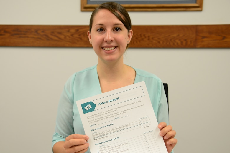 Rebecca Burbach, Malmstrom personal financial counselor, displays one of many budget resource tools available for customers Aug. 21, 2017, at Malmstrom Air Force Base, Mont.