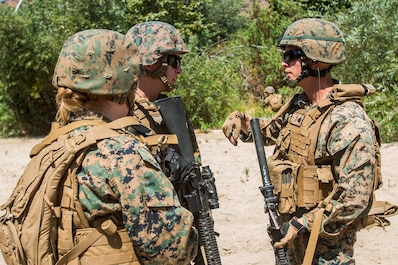 U.S. Marines with Combat Logistic Battalion 13 discuss a fragmentary order during a field medical training exercise on Marine Corps Base Camp Pendleton, Jul. 8, 2017. After four days of classroom instruction the Marines were evaluated with a hyper realistic trauma range designed to test their skills under pressure.