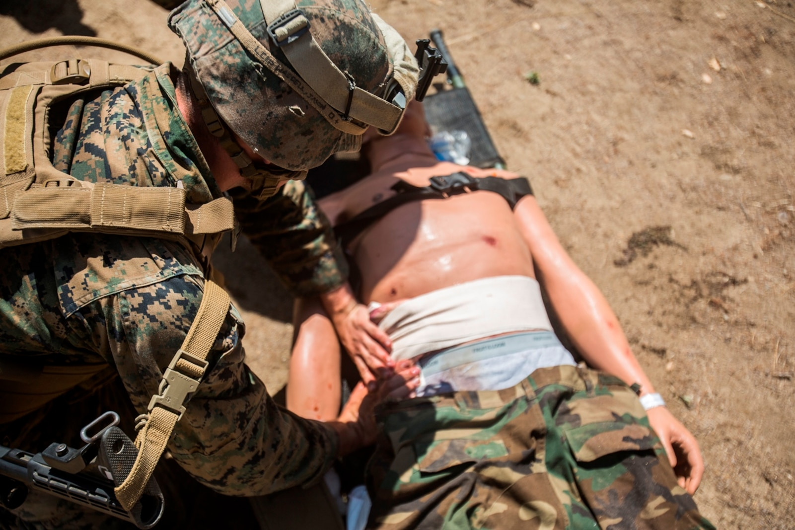 U.S. Marine Lance Cpl. Jason L. Waddell, a motor vehicle operator with Combat Logistics Battalion 13, provides triage to a simulated casualty during a field medical exercise on Marine Corps Base Camp Pendleton, Calif., Jul. 18, 2017. The exercise is focused on providing units with a combined arms training regimen with a focus on medical abilities.