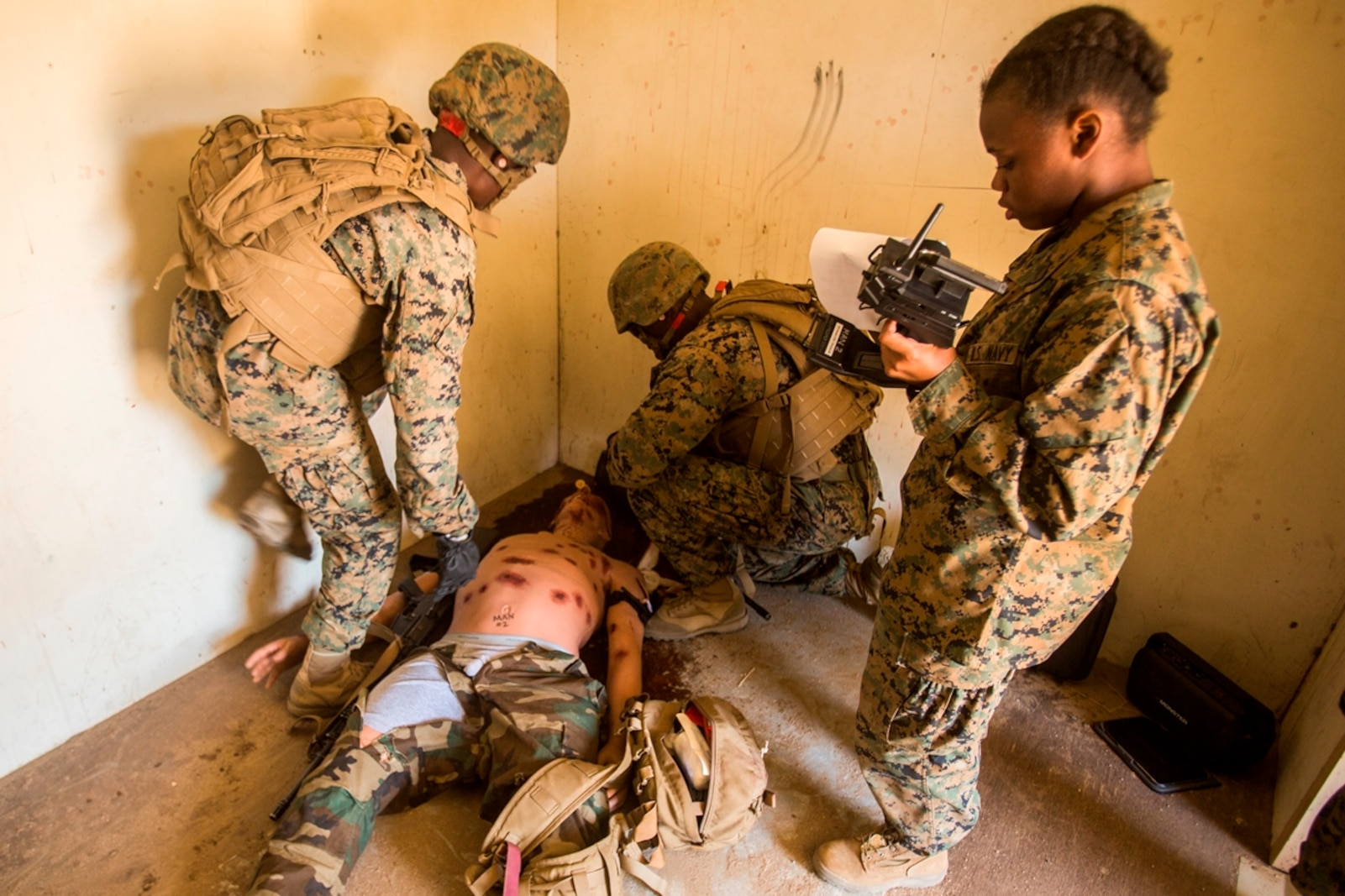 U.S. Marines treat a trauma manikin while being evaluated by a U.S. Navy corpsman during a field medical exercise on Marine Corps Base Camp Pendleton, Calif., Jul. 18, 2017. The trauma manikins provide students with are not only anatomically correct but allow training on various wounds to include amputation, sucking chest wounds, fractures, gunshot wounds, abdominal eviscerations and airway compromise due to facial trauma.