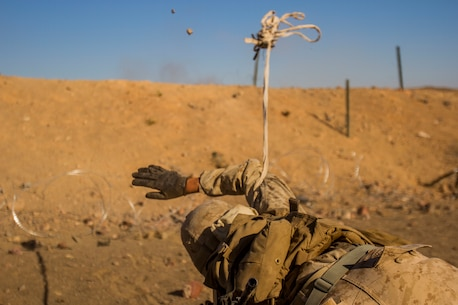 Lance Cpl. Jerry Holley, a combat engineer with 1st Combat engineer Battalion, 1st Marine Division, throws a grappling hook while breaching a wire obstacle during a Marine Corps Combat Readiness Evaluation (MCCRE) at Marine Air Ground Combat Center Twentynine Palms, Calif., July 14, 2017. The 2/7 MCCRE is in preparation for the upcoming deployment with the Special Purpose Marine Air Ground Task Force. (U.S. Marine Corps photo by Cpl. Justin Huffty)