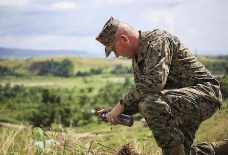 U.S. Marine Corps Sgt. Maj. William T. Sowers, sergeant major of 1st Marine Division, collects soil during a tour of Bloody Ridge in Guadalcanal, Solomon Islands, Aug. 9, 2017. The tour was used to teach the Marines about Bloody Ridge and the Battle of Guadalcanal, which took place from Aug. 7, 1942 to Feb. 9, 1943. (U.S. Marine Corps photo by Sgt. Wesley Timm)