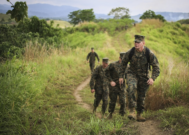 U.S. Marine Corps Sgt. Jeremy Pogue, a rifleman with 1st Battalion, 1st Marine Regiment, 1st Marine Division, hikes to Gunnery Sgt. John Basilone's fighting hole during a tour of Bloody Ridge in Guadalcanal, Solomon Islands, Aug. 9, 2017. The tour was used to teach the Marines about Bloody Ridge and the Battle of Guadalcanal, which took place from Aug. 7, 1942 to Feb. 9, 1943. (U.S. Marine Corps photo by Sgt. Wesley Timm)