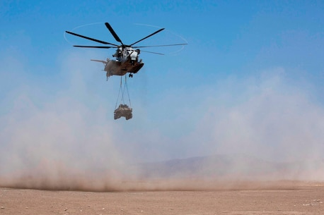 A U.S. Marine CH-53E helicopter prepares for landing and disconnect of equipment during a Helicopter Support Team exercise on Marine Corps Base Camp Pendleton, Calif., Aug. 22, 2017. A HST is utilized for all helicopter-borne operations to include support of the evacuation of casualties and enemy prisoner of war. (U.S. Marine Corps photo by Lance Cpl. Gabino Perez)