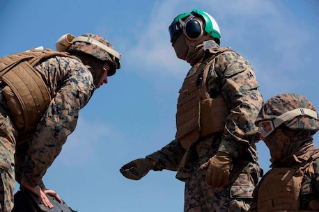 U.S. Marine Sgt. Roberto A. Derequesensnieves, a landing support specialist with Landing Support Company, 1st Transportation Support Battalion, Combat Logistics Regiment 1, 1st Marine Logistics Group, briefs his Marines before a lift during a Helicopter Support Team exercise on Marine Corps Base Camp Pendleton, Calif., Aug. 22, 2017. Supporting units will also learn how to conduct post external lift operations such as gear accountability and storage procedures. (U.S. Marine Corps photo by Lance Cpl. Gabino Perez)