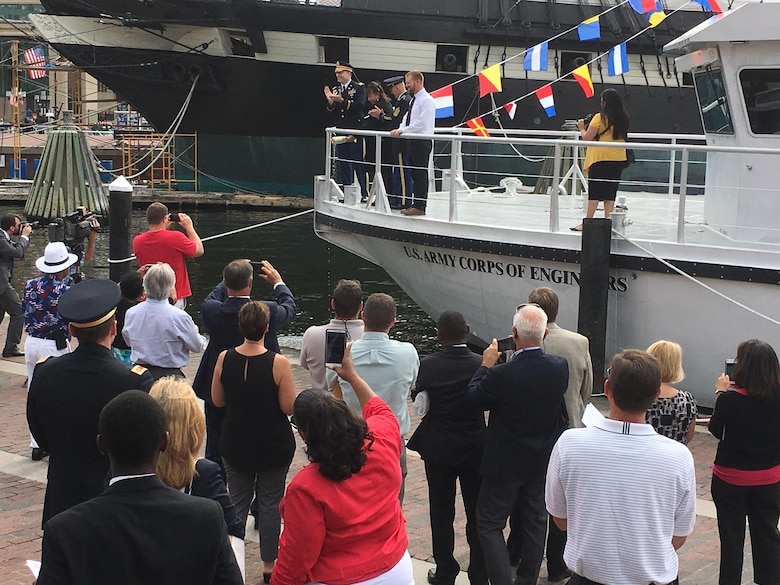 Angela Leone, with U.S. Army Corps of Engineers, Baltimore District, Commander Col. Ed. Chamberlayne, U.S. Army Corps of Engineers, Headquarters, Command Sgt. Maj. Bradley Houston and Survey Vessel CATLETT Captain Ryan Schuman, prepares to christen Survey Vessel CATLETT during a ceremony in Baltimore's Inner Harbor Thursday morning August 24, 2017. The hydrographic survey vessel is the newest vessel in Baltimore District's fleet and is named for Leone's brother, the late Harold Catlett who served as a hydrographic surveyor with Baltimore District for roughly 30 years before his sudden passing in 2014.