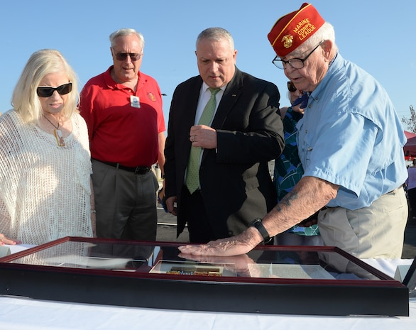 Officials cut ribbon, dedicate building to Marine Corps hero