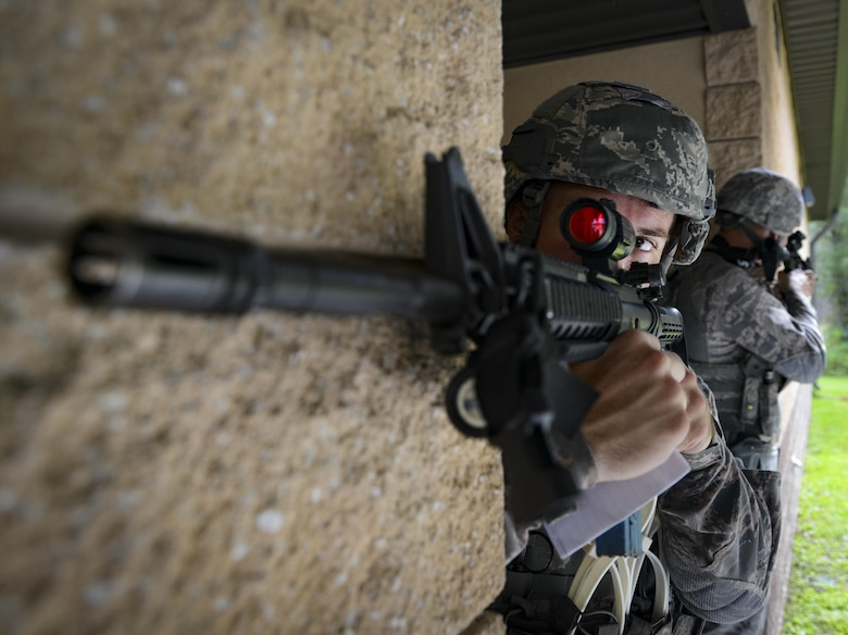 Staff Sgt. Brent Palmer, 23d Security Forces Squadron patrolman, guards an entry control during an emergency response exercise, Aug. 22, 2017, at Moody Air Force Base, Ga. The purpose of this active-shooter exercise was to inspect the recovery phase of an emergency situation while maintaining realism as members still responded as normal. (U.S. Air Force photo by Airman 1st Class Lauren M. Sprunk)
