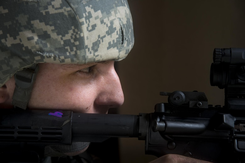Senior Airman Dennis Capps, 23d Security Forces Squadron patrolman, guards an entry control point during an emergency response exercise, Aug. 22, 2017, at Moody Air Force Base, Ga. The purpose of this active-shooter exercise was to inspect the recovery phase of an emergency situation while maintaining realism as members still responded as normal. (U.S. Air Force photo by Airman 1st Class Erick Requadt)