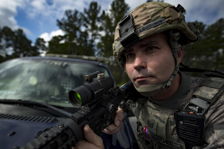 Tech. Sgt. Bert Leuschen, 23d Security Forces Squadron flight sergeant, secures the scene of an emergency response exercise, Aug. 22, 2017, at Moody Air Force Base, Ga. The purpose of this active-shooter exercise was to inspect the recovery phase of an emergency situation while maintaining realism as members still responded as normal. (U.S. Air Force photo by Airman 1st Class Daniel Snider)