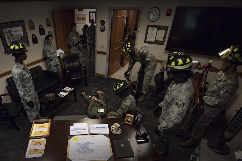Firefighters respond during an emergency response exercise while members of the 23d Wing Inspection Team observe, Aug. 22, 2017, at Moody Air Force Base, Ga. The purpose of this active-shooter exercise was to inspect the recovery phase of an emergency situation while maintaining realism as members still responded as normal. (U.S. Air Force photo by Airman 1st Class Daniel Snider)