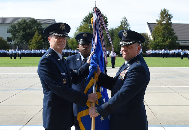 Lt. Gen. Darryl Roberson, commander of Air Education and Training Command commander, passes the 2nd Air Force guidon to Maj. Gen. Timothy Leahy, 2nd AF commander, during the 2nd AF change of command ceremony at the Levitow Training Support Facility Aug. 23, 2017, on Keesler Air Force Base, Miss. L (U.S. Air Force photo by Kemberly Groue)