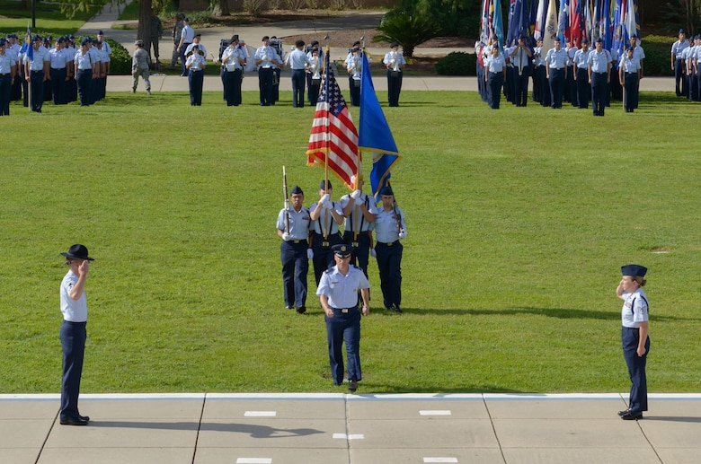 Col. Todd Weyerstrass, 2nd Air Force vice commander, leads the colors onto the parade field during the 2nd AF change of command ceremony at the Levitow Training Support Facility Aug. 23, 2017, on Keesler Air Force Base, Miss. (U.S. Air Force photo by André Askew)