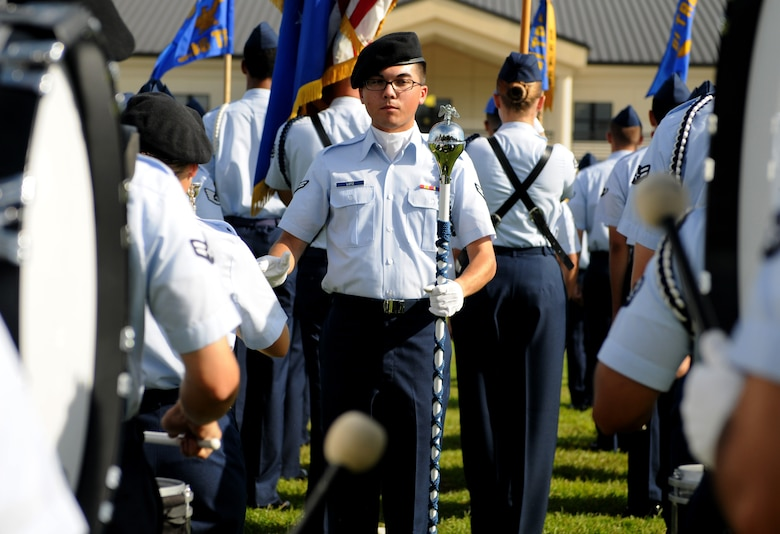 Airman 1st Class Nicholas Lotz, 338th Training Squadron student, leads the 81st Training Group Drum and Bugle Corps during the 2nd Air Force change of command ceremony at the Levitow Training Support Facility Aug. 23, 2017, on Keesler Air Force Base, Miss. Maj. Gen. Timothy Leahy took command of 2nd AF during the ceremony from Maj. Gen. Bob LaBrutta. (U.S. Air Force photo by Senior Airman Holly Mansfield)