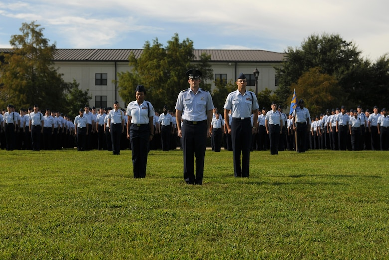 Maj. Nick Moore, 335th Training Squadron comptroller training flight commander, commands a squadron of 81st Training Group Airmen during the 2nd Air Force change of command ceremony at the Levitow Training Support Facility Aug. 23, 2017, on Keesler Air Force Base, Miss. Maj. Gen. Timothy Leahy took command of 2nd AF during the ceremony from Maj. Gen. Bob LaBrutta. (U.S. Air Force photo by Senior Airman Holly Mansfield)