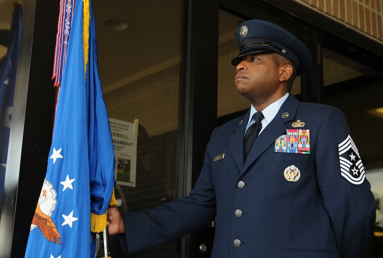 Chief Master Sgt. Farrell Thomas, 2nd Air Force command chief, holds the Air Force flag during the 2nd AF change of command ceremony at the Levitow Training Support Facility Aug. 23, 2017, on Keesler Air Force Base, Miss. Maj. Gen. Timothy Leahy took command of 2nd AF during the ceremony from Maj. Gen. Bob LaBrutta. (U.S. Air Force photo by Senior Airman Holly Mansfield)