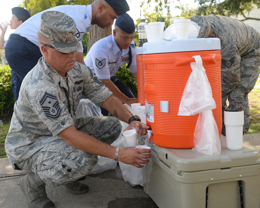 Senior Master Sgt. Joseph Clifford, 336th Training Squadron first sergeant, fills a cup with water during the 2nd Air Force change of command ceremony at the Levitow Training Support Facility Aug. 23, 2017, on Keesler Air Force Base, Miss. Maj. Gen. Timothy Leahy took command of 2nd AF during the ceremony from Maj. Gen. Bob LaBrutta. (U.S. Air Force photo by Senior Airman Travis Beihl)