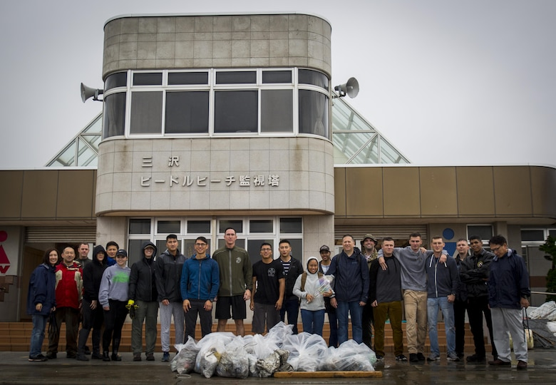 Marines, Sailors, Airmen banded together with Misawa City employees to participate in the beach cleanup.