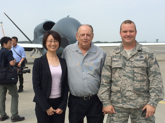 Mike Bishop standing with Ms. Makiko Oshima, Deputy Director, Treaties Division, Ministry of Foreign Affairs, and Master Sgt. Steven Lyonnais, Misawa Air Base's Airfield Manager, pose for a photo in front of an RQ-4 Global Hawk on the flight line of Misawa AB, May 30, 2014. (Courtesy Photo)