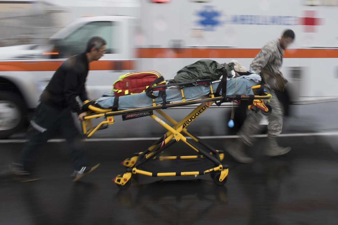 Emergency responders from the 374th Medical Group transport a simulated victim during an active shooter exercise, Aug. 16, 2017, at Yokota Air Base, Japan. The top priority after an active shooter event is tending to any wounded to prevent further possible loss of life. (U.S. Air Force photo by Airman 1st Class Donald Hudson)