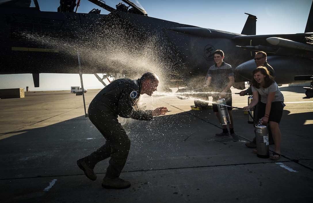 Col. Jefferson O'Donnell, 366th Fighter Wing commander, gets doused with water from his children and Vice Wing Commander Col. David Brynteson following his final flight at Mountain Home Air Force Base, Idaho, Aug. 16, 2017. O'Donnell will relinquish command of the 366th FW to Col. Joseph Kunkel during a change of command ceremony Sept. 8. O'Donnell's next assignment will be serving as Director, Air Force Colonels Management Office, at the Pentagon. (U.S. Air Force photo/Senior Airman Samuel Morse)