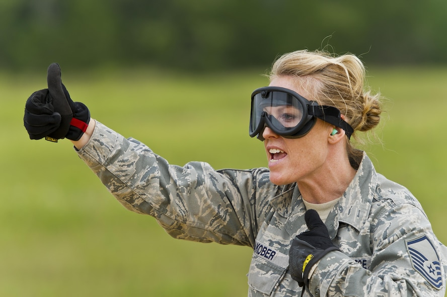 U.S. Air Force Master Sgt. Ashby Jakober, 445th Aeromedical Staging Squadron, Wright-Patterson AFB, Ohio, coordinates en-route patient movement during exercise Patriot Warrior at Young Air Assault Strip, Fort McCoy, Wis., Aug. 18, 2017. More than 600 Reserve Citizen Airmen and over 10,000 soldiers, sailors, Marines and international partners converged on the state of Wisconsin to support a range of interlinked exercises including Patriot Warrior, Global Medic, CSTX, Diamond Saber, and Mortuary Affairs Exercise (MAX).  Patriot Warrior is Air Force Reserve Command's premier exercise, providing an opportunity for Reserve Citizen Airmen to train with joint and international partners in airlift, aeromedical evacuation and mobility support.  This exercise is intended to test the ability of the Air Force Reserve to provide combat-ready forces to operate in dynamic, contested environments and to sharpen Citizen Airmen's skills in supporting combatant commander requirements. ( U.S. Air Force Photo by Tech. Sgt. Efren Lopez )